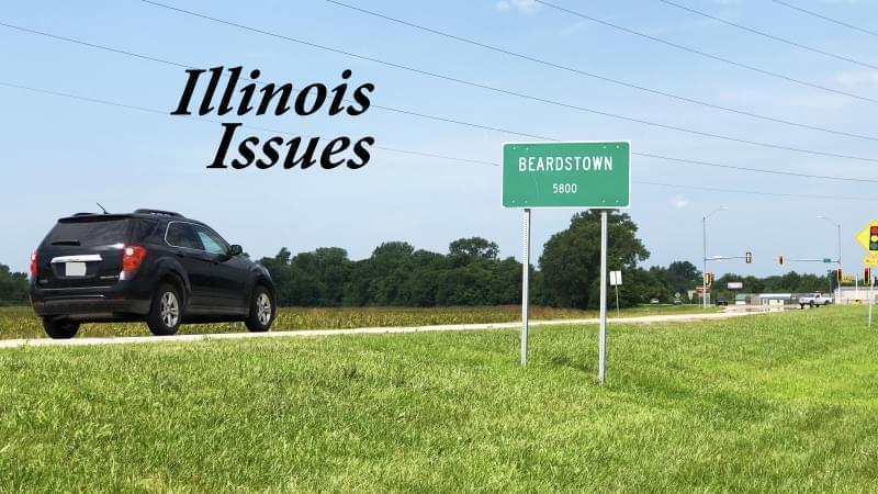 A car approaching a road sign for the city limits of Beardstown.