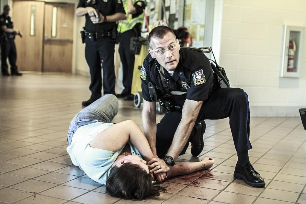 "A Paducah Police officer aids a ""victim"" during an active-shooter mock exercise at West Kentucky Community and Technical College."