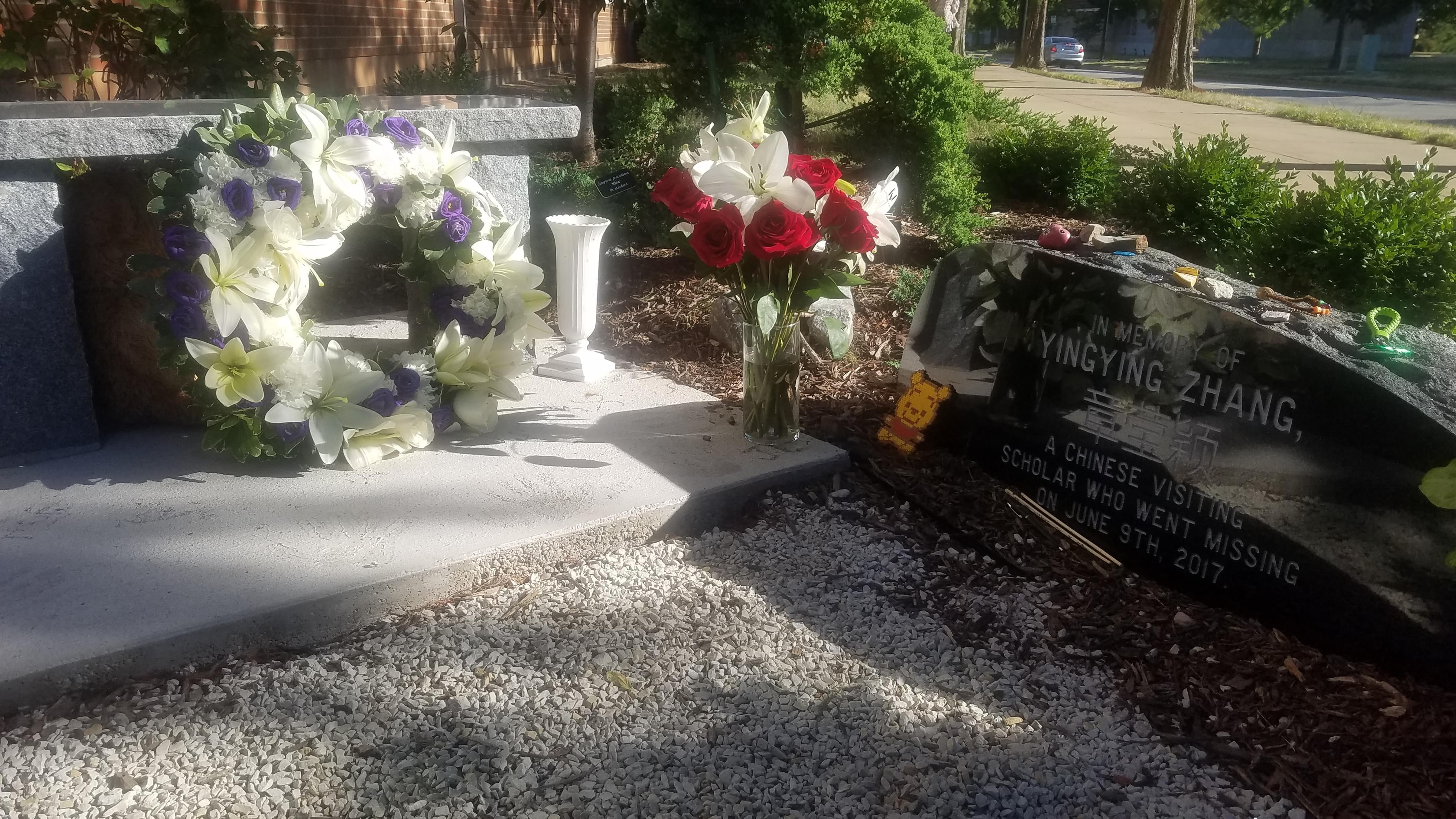 A wreath and flowers decorate the Yingying Zhang Memorial Garden.