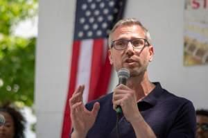 Illinois Treasurer Michael Frerichs delivers remarks at the Governor's Day Picnic at the Illinois State Fairgrounds on Aug. 14