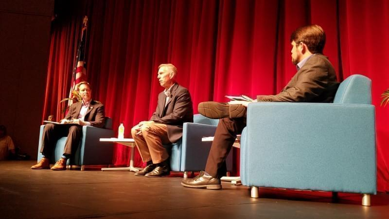 Congressman Rodney Davis, State Representative Brad Holbrook and Steve Beatty of WDWS Radio share the stage at Davis' Open Government Night event.