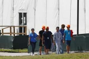 Migrant children walk outside the Homestead Temporary Shelter for Unaccompanied Children in May in Homestead, Fla.
