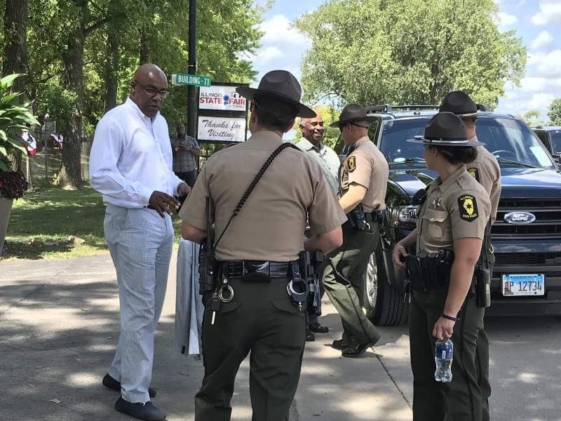 At left, Attorney General Kwame Raoul speaks with Illinois State Troopers following an event at the Illinois State Fair on Aug. 14.
