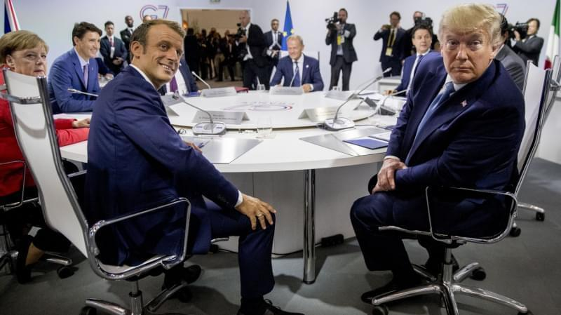 French President Emmanuel Macron (left) and President Trump participate in a G-7 working session. Trump is in Biarritz, France, for the G-7 summit of the world's biggest economic powers.