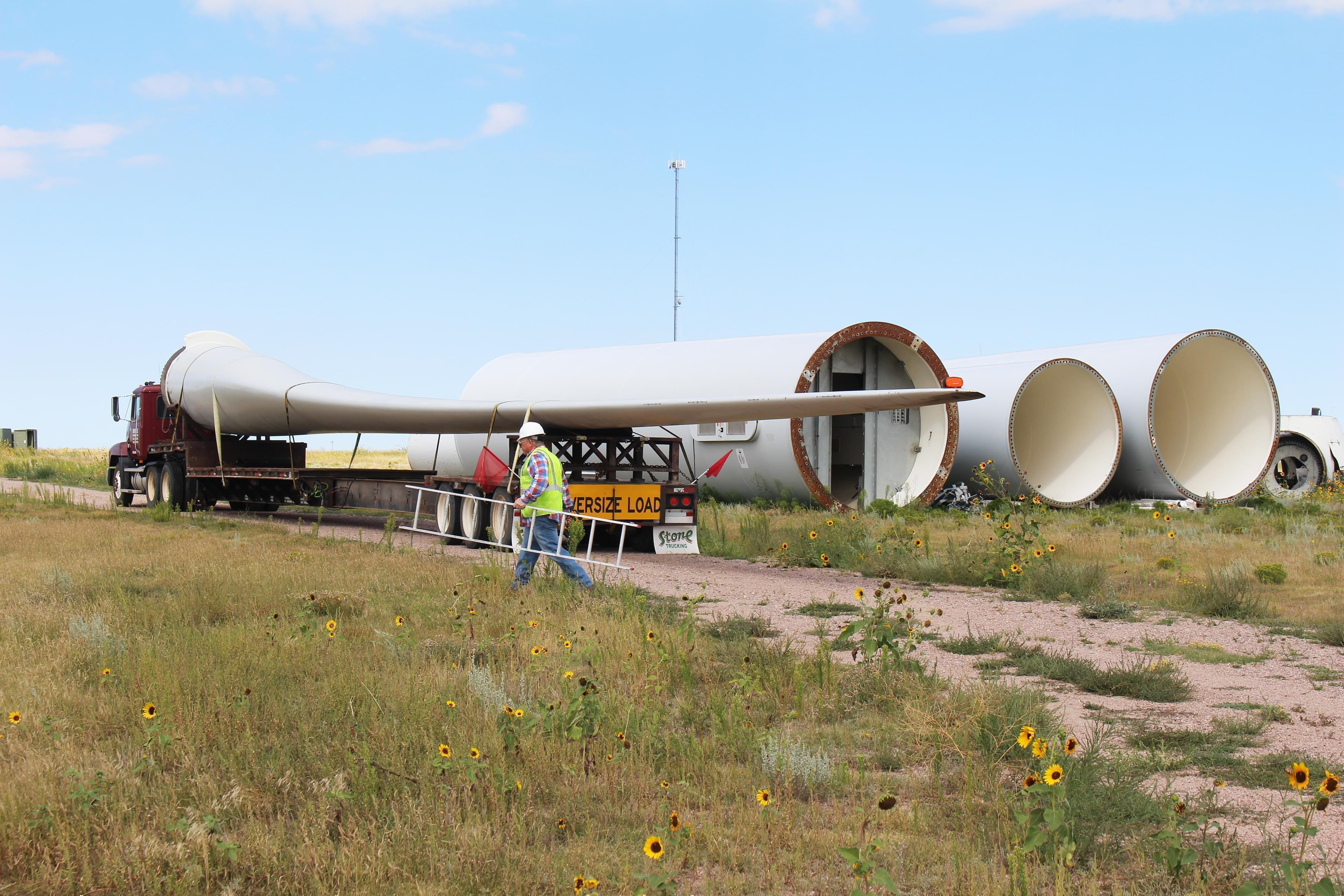 Rob Van Vleet secures a wind turbine blade onto an oversized truck at the Kimball Wind Farm in southwest Nebraska.