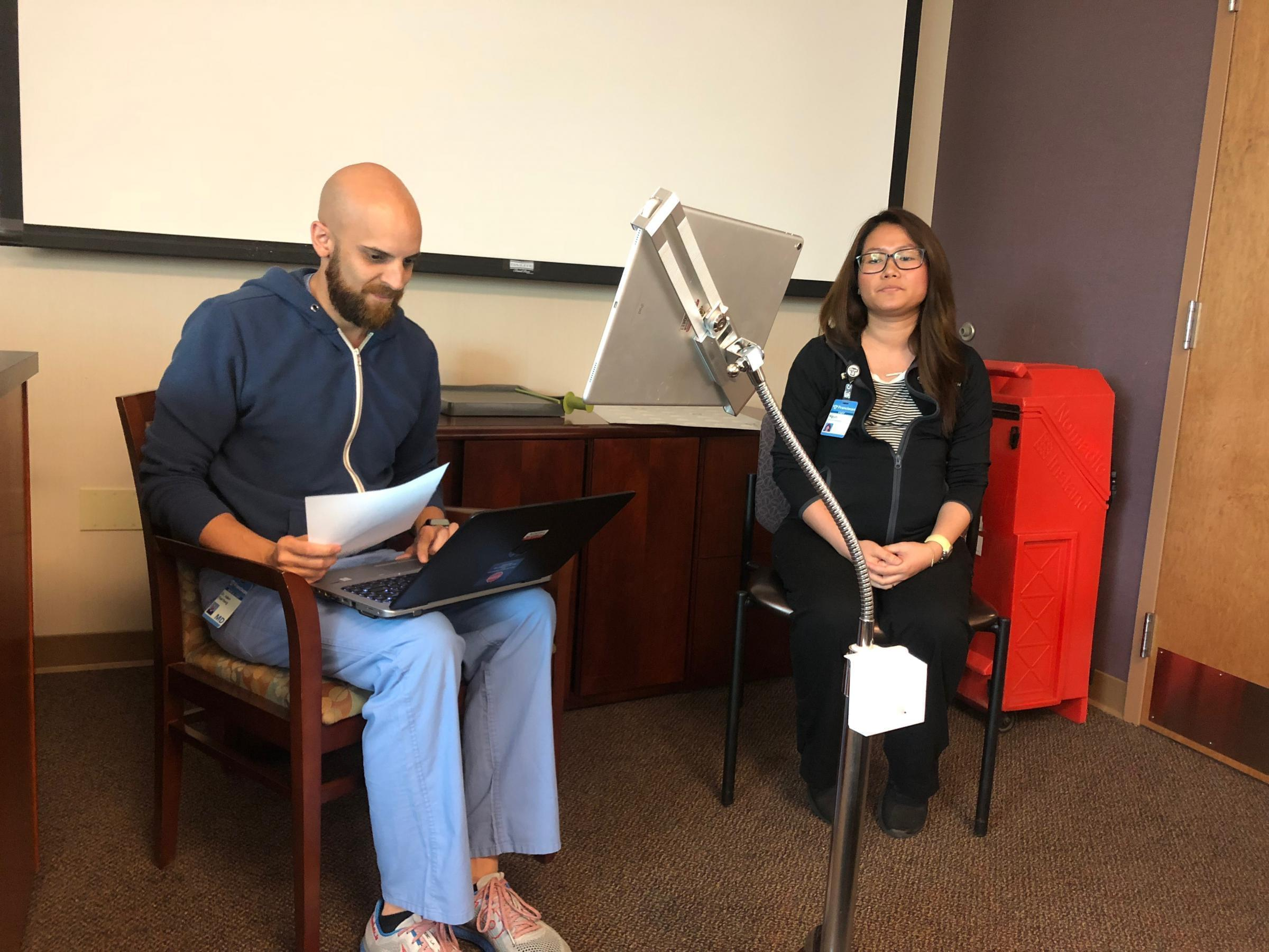 Adam Paarlberg and medical assistant Ngun Tial demonstrate how the live interpreter MARTI system works.