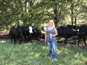 Holly Bickmeyer and cattle on the small farm she manages. She wants control over large livestock operations to stay local.