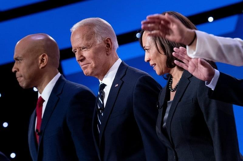 Democratic presidential hopefuls (from left): Sen. Cory Booker, D-N.J., former Vice President Joe Biden, and Sen. Kamala Harris, D-Calif., on stage before the July debate.
