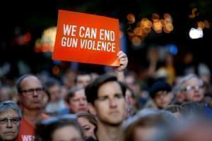 A demonstrator holds up an anti-gun violence sign.