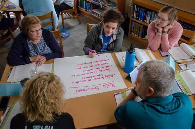 Storm Lake District teachers participate in an activity for Youth Mental Health First Aid. The course teaches educators how to spot mental illness in kids and how to get them help.
