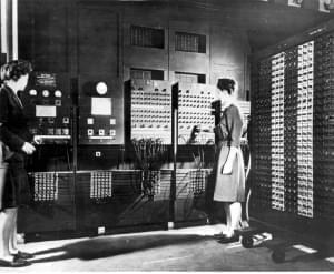 Two women working with the early computer ENIAC
