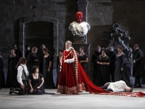 A group of people perform an opera on stage.