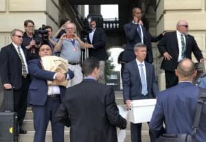 FBI agents removed cardboard boxes, paper bags and at least one computer from the Springfield offices of state Sen. Martin Sandoval in this file photo from Sept. 24, 2019.