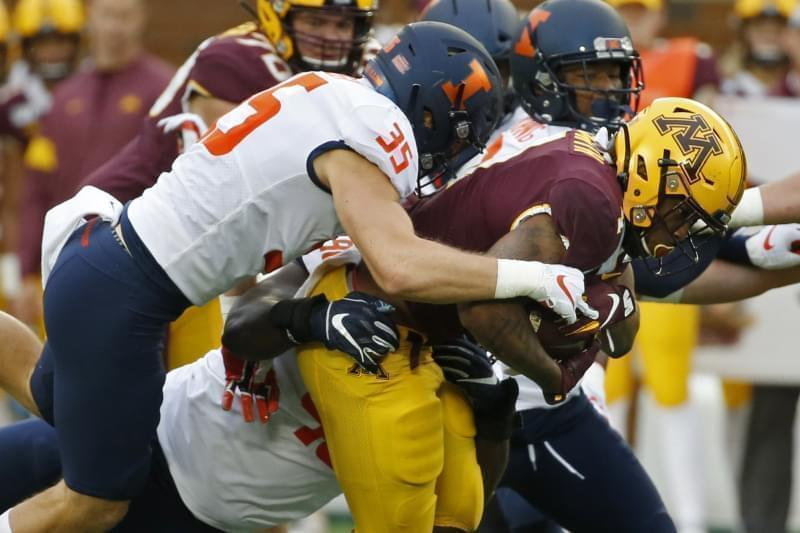 Illinois linebacker Jake Hansen (35) stops Minnesota running back Rodney Smith (1) on a run in the first quarter of an NCAA college football game Saturday, Oct. 5, 2019, in Minneapolis.