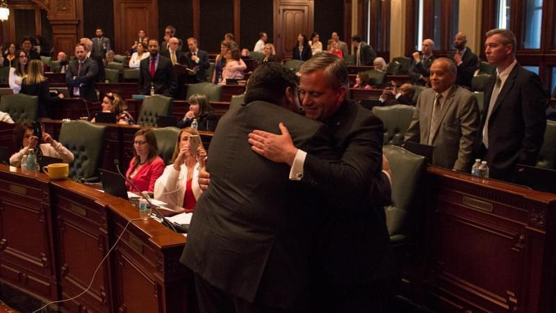 Gov. J.B. Pritzker hugged Rep. Robert Martwick after the Illinois House approved a a graduated income tax constitutional amendment earlier this year.