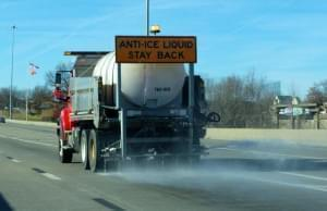 A brining truck sprays saltwater on the roadways ahead of a winter storm in December 2016.