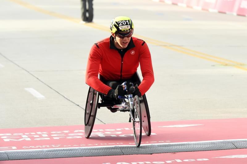 Daniel Romanchuk wins the Men's Wheelchair Chicago Marathon Sunday, in Chicago.