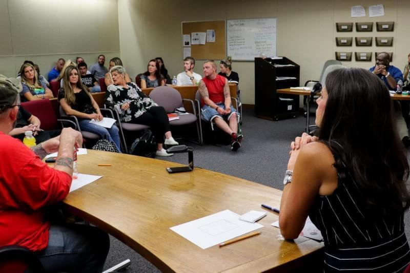 Judge Jodi Thomas, right, speaks to HART participants during a weekly meeting.
