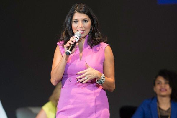 Rebecca Guyette speaking on a stage