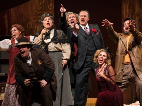 The Opera Delaware Ensemble performs Gianni Schicchi & Buoso's Ghost on a stage.