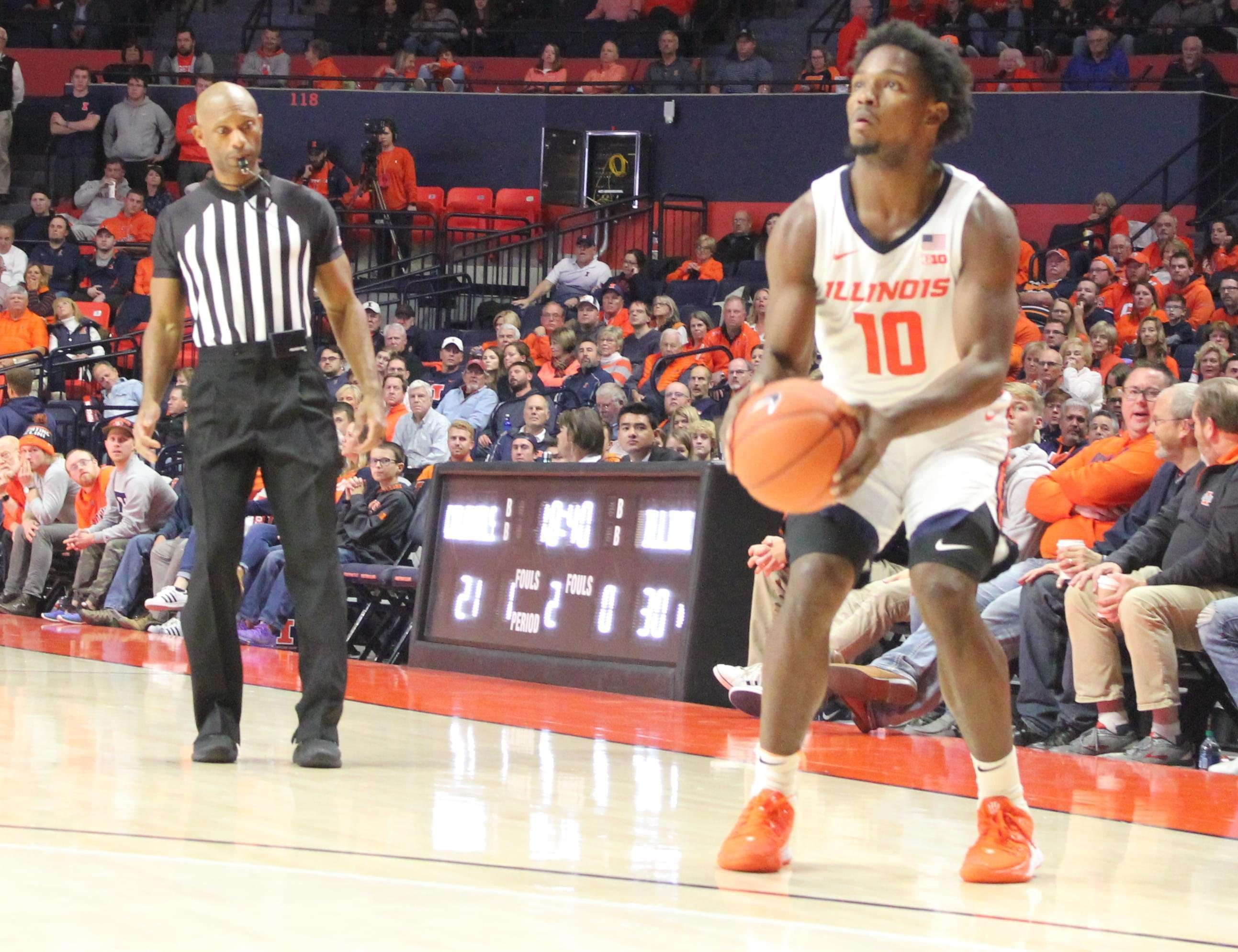 Andre Feliz squares up for a three-pointer during Illinois' 78-70 overtime win over Nicholls State.