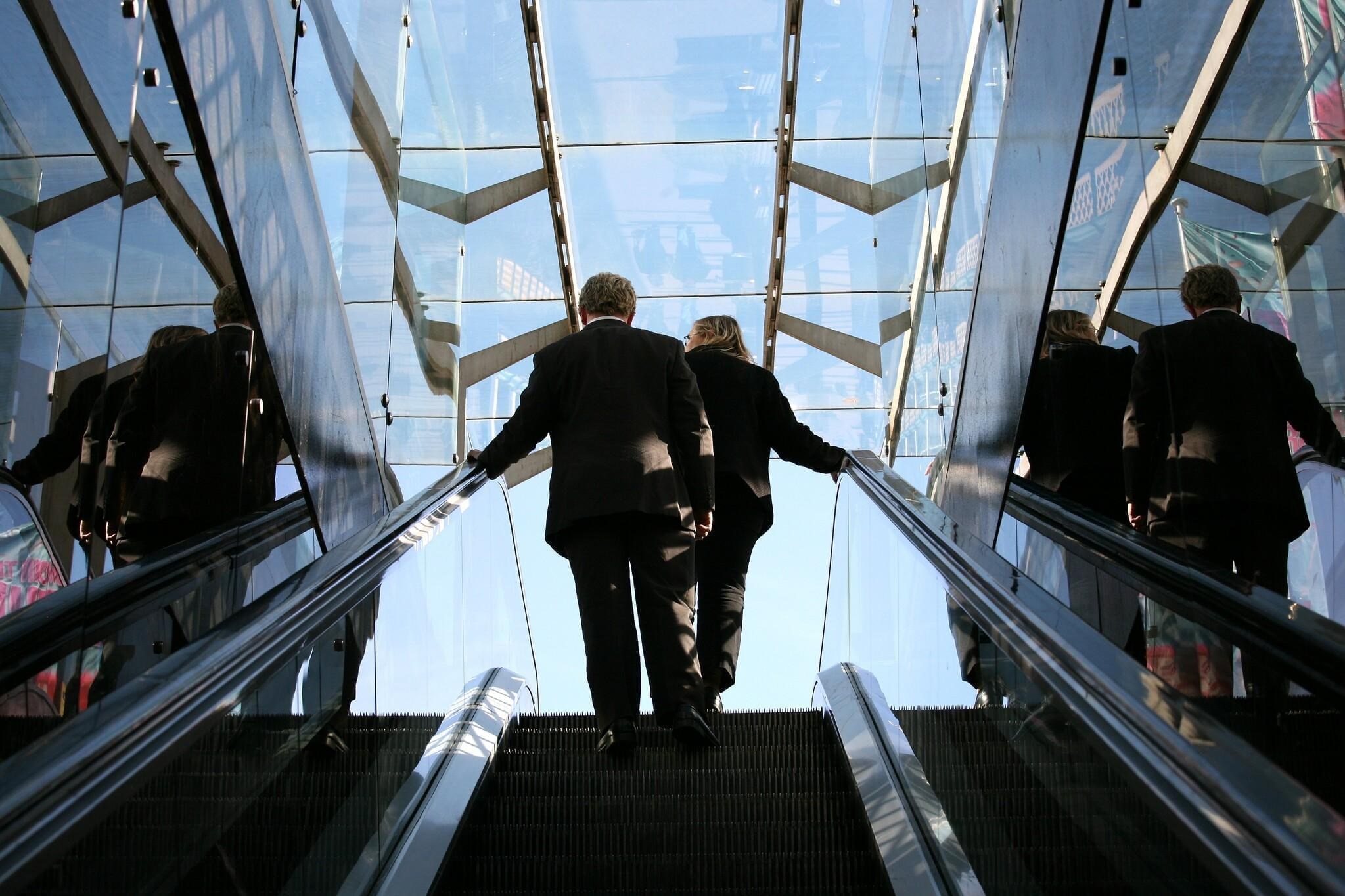 People on an escalator.