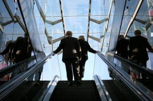 People on an escalator.