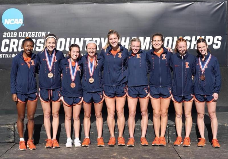 The Illinois women's cross country team celebrating their NCAA Regional title.