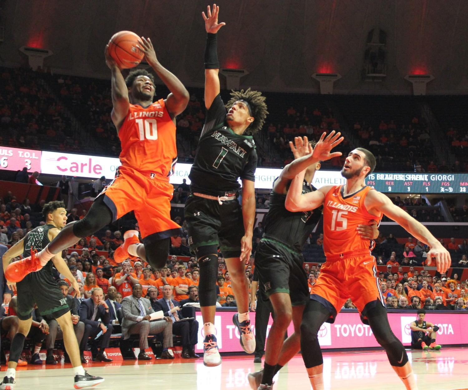 Andres Feliz of Illinois drives to the basket.