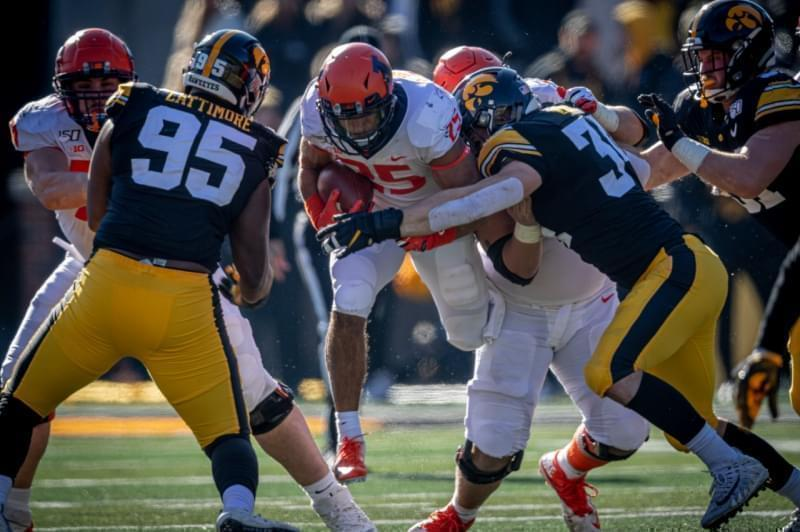 Illinois running back Dre Brown tries to run through the Iowa defense at Kinnick Stadium on Saturday.