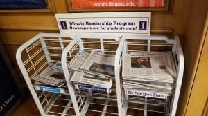A newspaper rack for the Illinois Readership Program at the University of Illinois Illini Union.