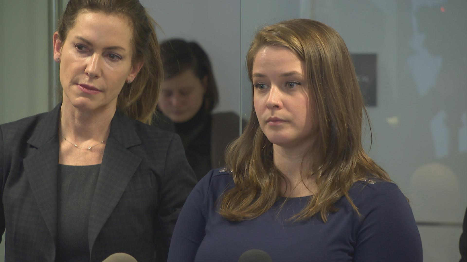 Alaina Hampton, right, speaks with reporters about her sexual harassment complaint in this file photo from 2018.