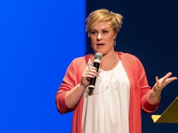 Tara Hurless speaking into a microphone
