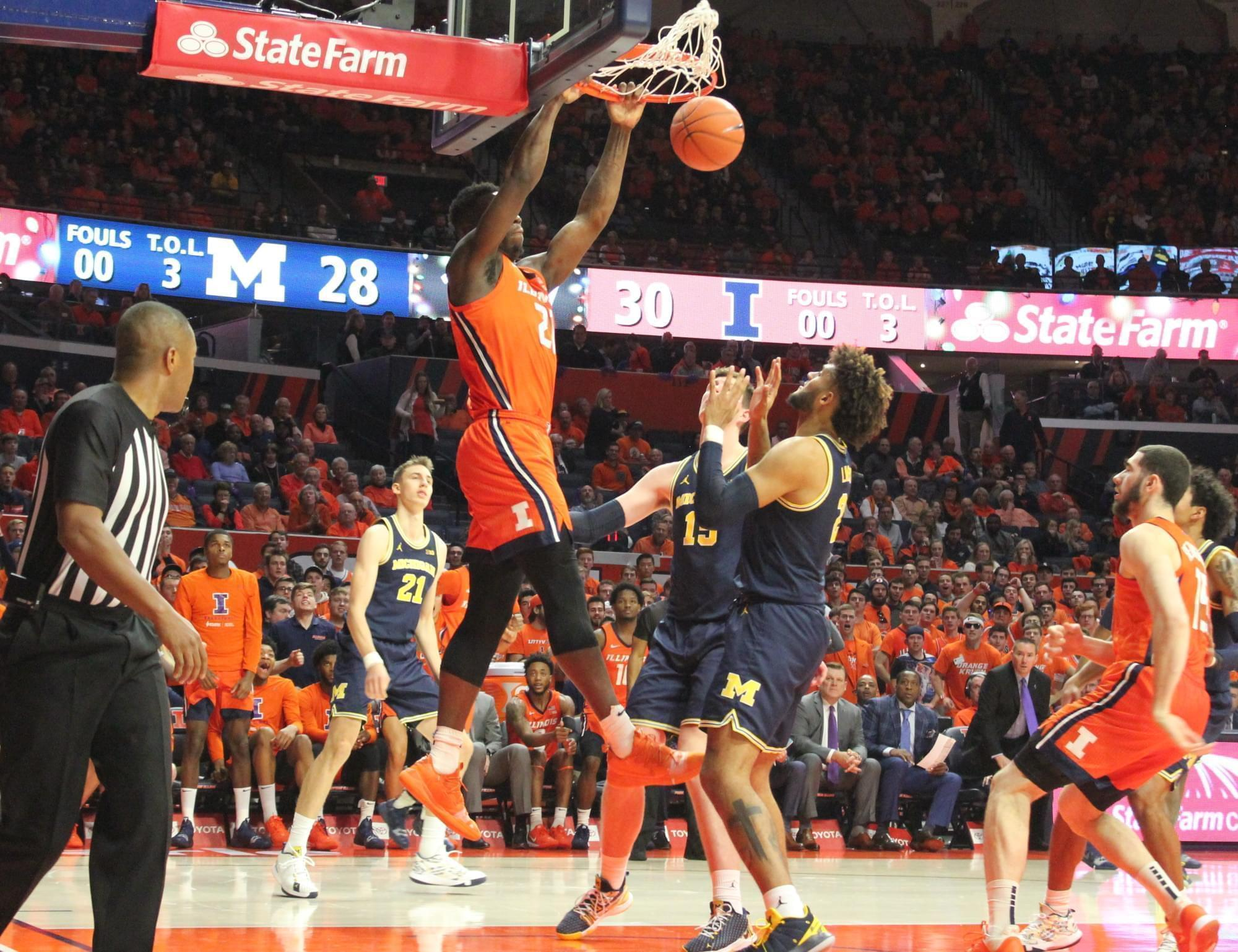 Kofi Cockburn slams in two of his 19 points during Illinois' 71-62 win over Michigan on Wednesday in Champaign.