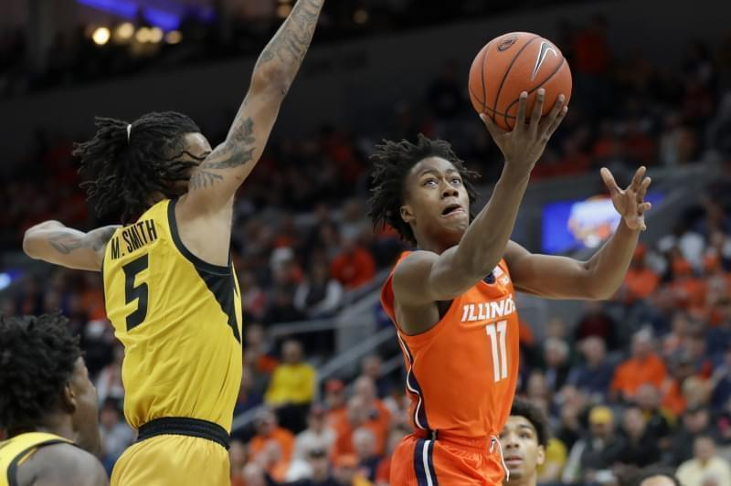Illinois' Ayo Dosunmu heads to the basket past Missouri's Mitchell Smith.