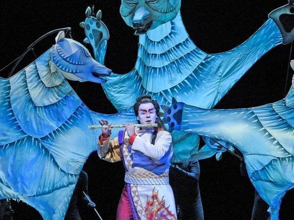 Performers in The Metropolitan Opera perform The Magic Flute on stage.