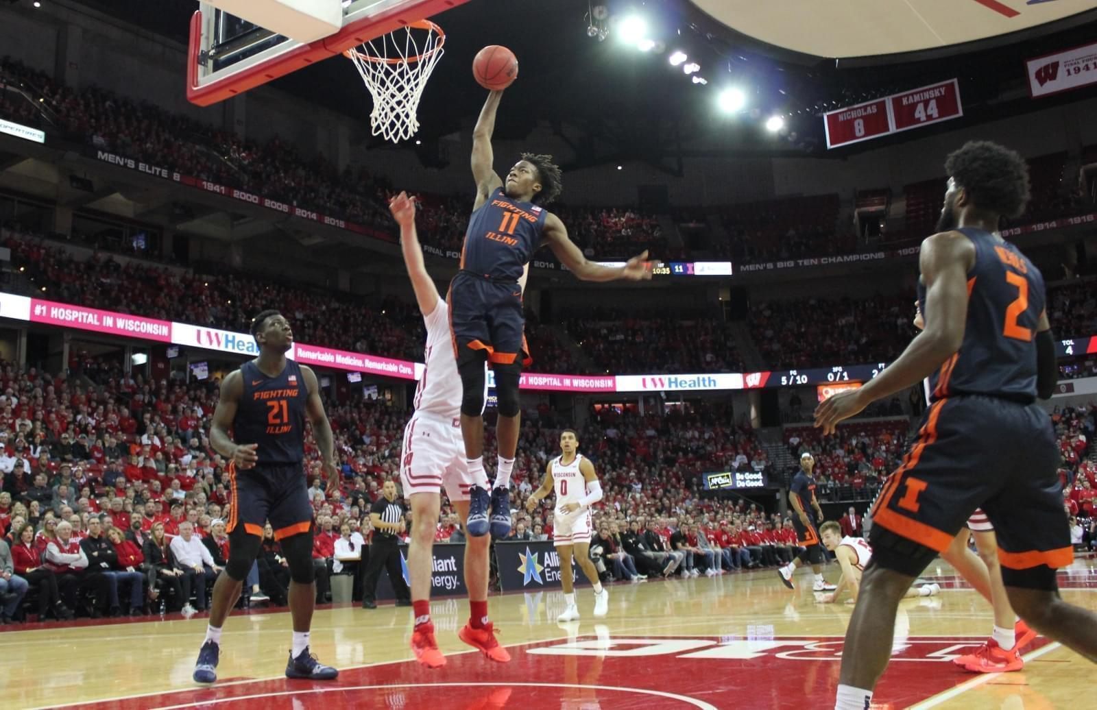Illinois' Ayo Dosunmu slams in two of his 18 points in the Illini's 71-70 win over Wisconsin Wednesday in Madison.