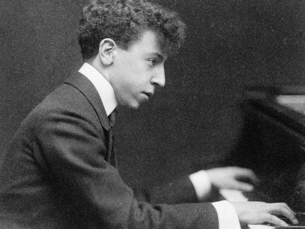 Arthur Rubinstein playing the piano.