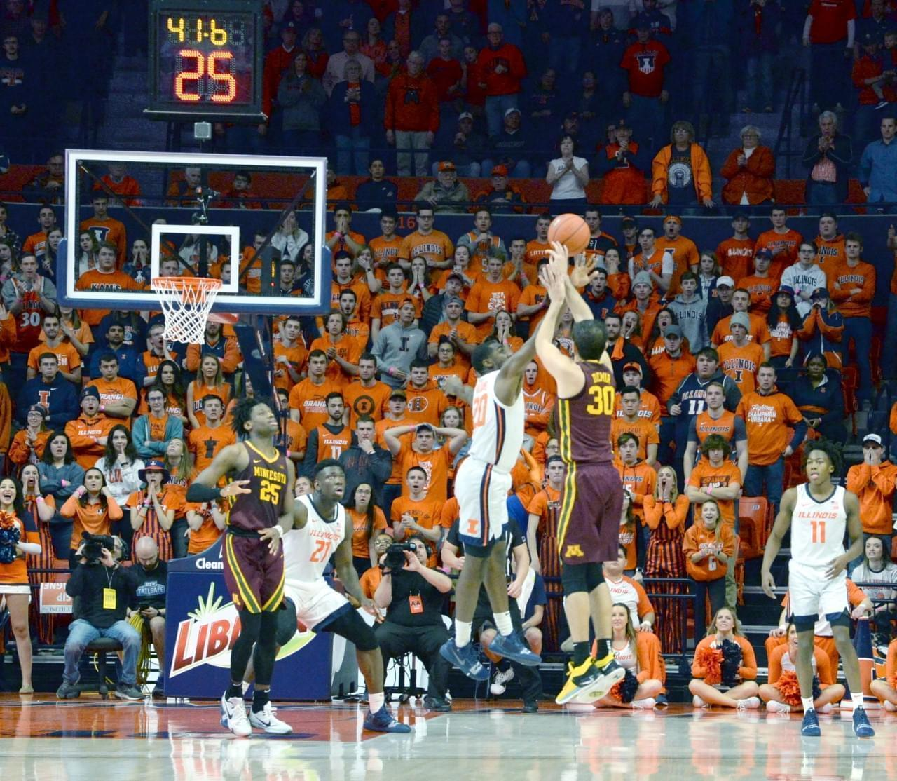 Da'Monte Williams blocks a game-tying attempt by Minnesota's Alihan Demir late in the Illini's 59-51 win on Thursday.