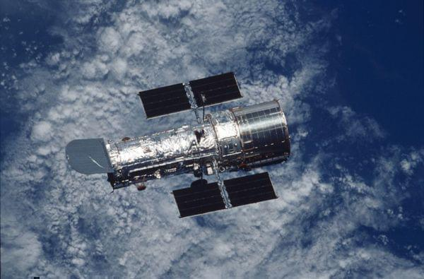 The Hubble Space Telescope orbiting above the Earth
