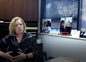 Susan Zola seated in her office
