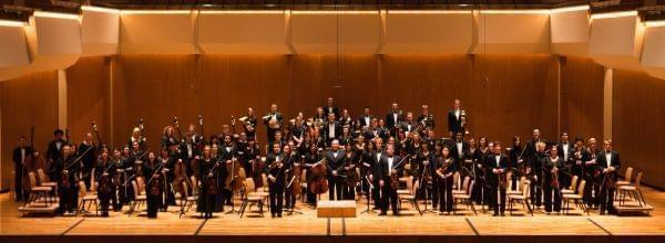 University of Illinois Symphony Orchestra performing on stage.