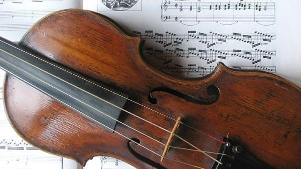 Violin sits on top of sheet music