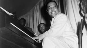 Duke Ellington plays the piano