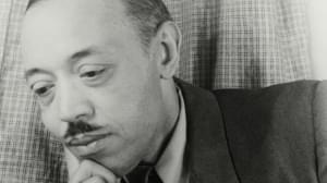 William Grant Still up close with hand on chin