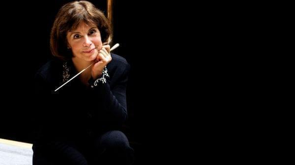 woman sitting on stage with baton