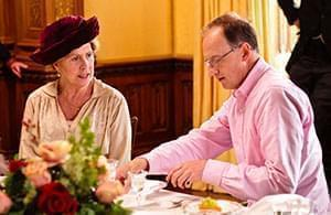 Alistair Bruce and Penelope Wilton (Isobel Crawley) discuss proper dining protocol.