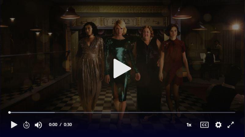 Four women walk through a bar, directly toward the camera. Click to play video.