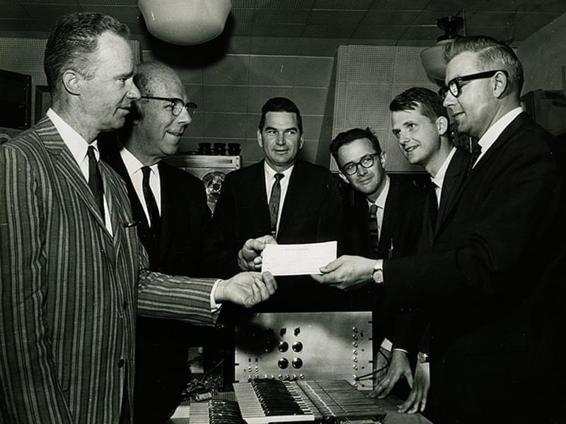 Beauchamp and other professors accepting a sponsorship check from a MagnaVox executive