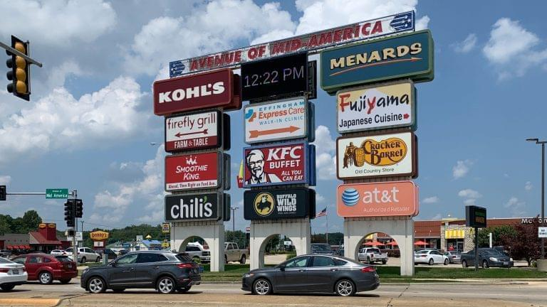 Effingham, located in Illinois' 15th Congressional District, is a hub for both travelers and commercial freight traffic. Here, a cluster of signs in Effingham advertise restaurant and shopping options.